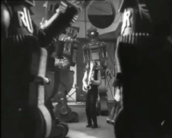 If, my robotic creations, I cannot control you in the montage showing military officials talking to each other via telephone, I will at least make you dance in this alcohol-influenced hallucination!