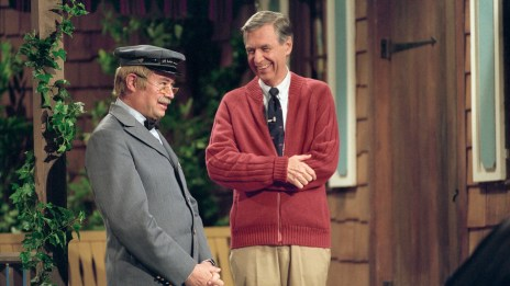 """Picture of Fred Rodgers in his trademark cardigan standing with Mr. McFeeley (portrayed by David Newell) in a still from the PBS TV show """"Mister Rogers' Neighborhood."""""""