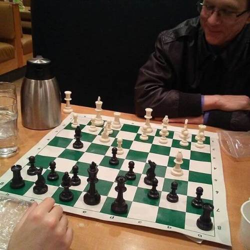 My brother, in town to see The Nutcracker, starts a chess game with my son
