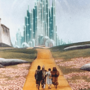 Scarecrow, Tin Man, Dorothy, and the Cowardly Lion approach Emerald City in this still from The Wizard of Oz
