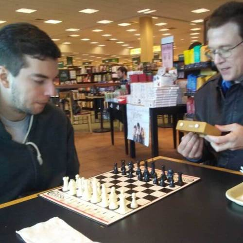 My big brother and my son facing off in chess. I am totally outclassed here.