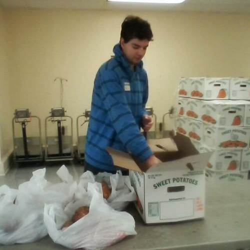 My son, volunteering at the local food bank.