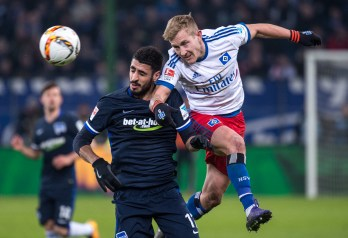 Lewis Holtby - HSV, wins a duel against Hertha BSC's Tolga Cigerci. 2016-03-06
