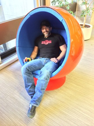 "Dirk in a ""womb chair"""