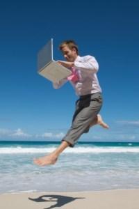 iStock_Joyous-computer-man-on-beach-XSmall.jpg