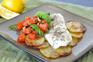 Baked Cod with Crispy Garlic Potatoes and Warm Tomato Salsa
