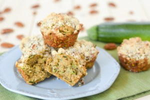 These Zucchini Coffee Cake Muffins are dense, moist and delicious, with a sweet and nutty streusel crumb topping.