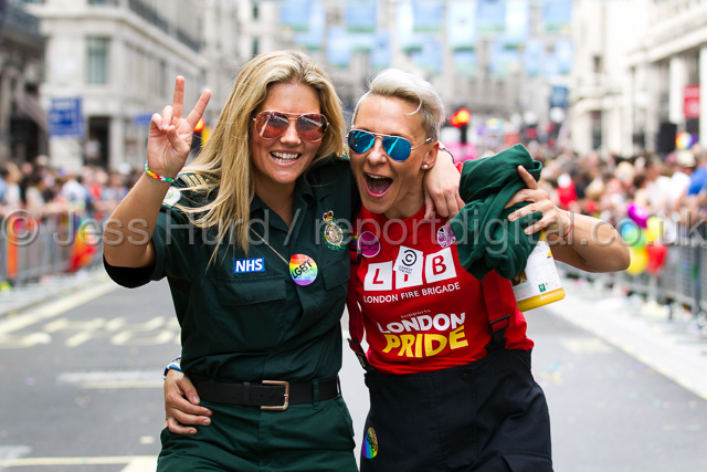 London firefighter and her ambulance worker girlfriend. Gay Pride, London 2015. © Jess Hurd/reportdigital.co.uk