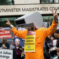 Protesting outside the Julian Assange US extradition hearing, Westminster Magistrates Court, London.