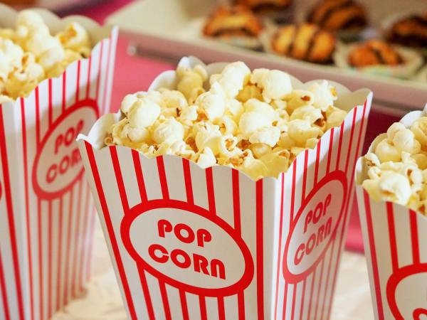 red and white carton of popcorn