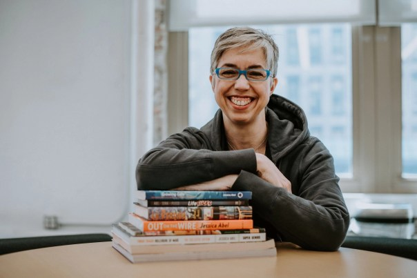 Jessica Abel with her books, photo by Maria Teicher