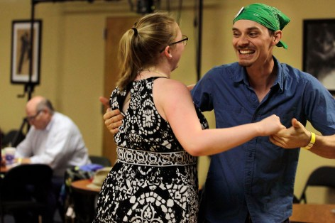 Samantha Fladung and Troy Thieszen laugh as they enjoy a dance together.