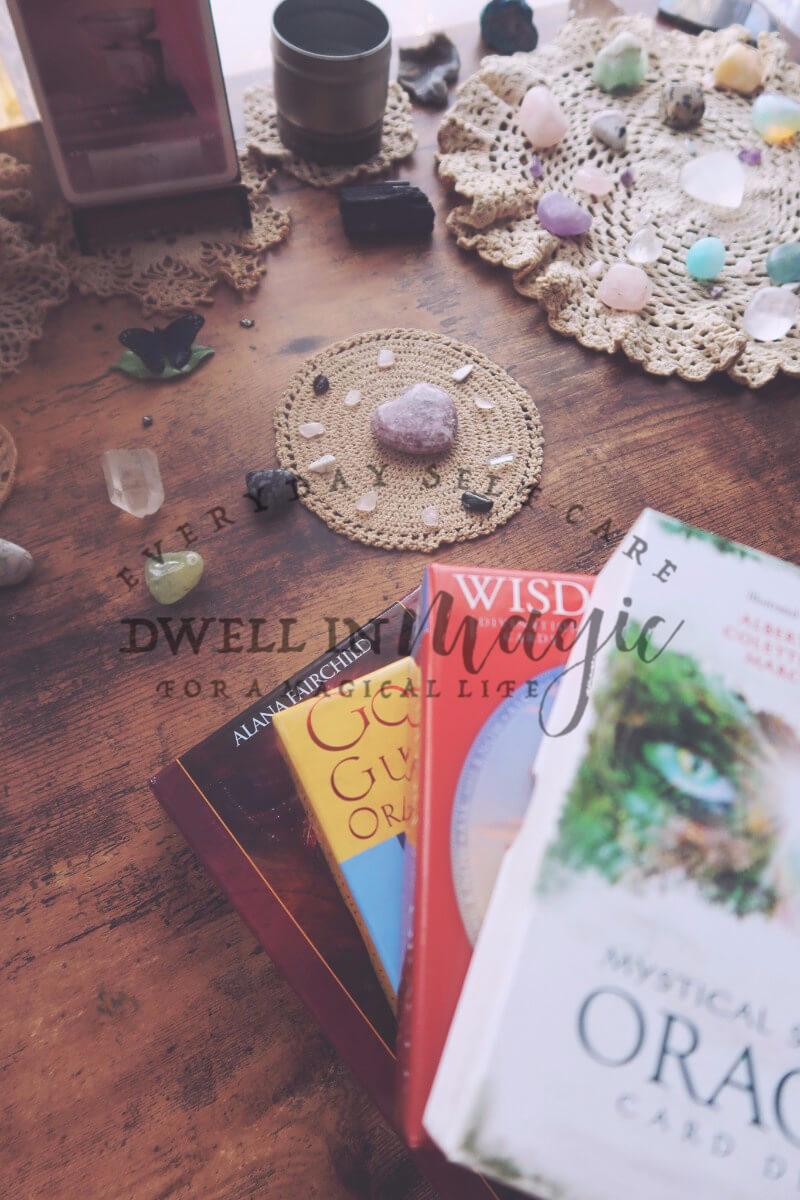 Pulling oracle cards, witchy self-care routine