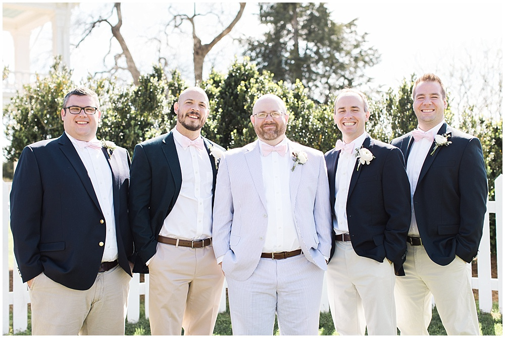 navy groomsmen suits with pink bow ties, navy and pink southern wedding   Ivan & Louise Images and Jessica Dum Wedding Coordination