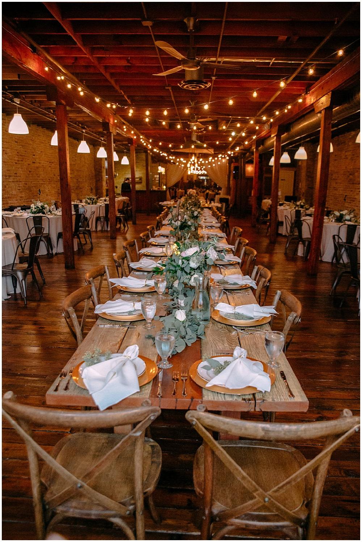 rustic farmhouse table with garland   Chicago urban rustic wedding  Sandra Armenteros Photography   Jessica Dum Wedding Coordination