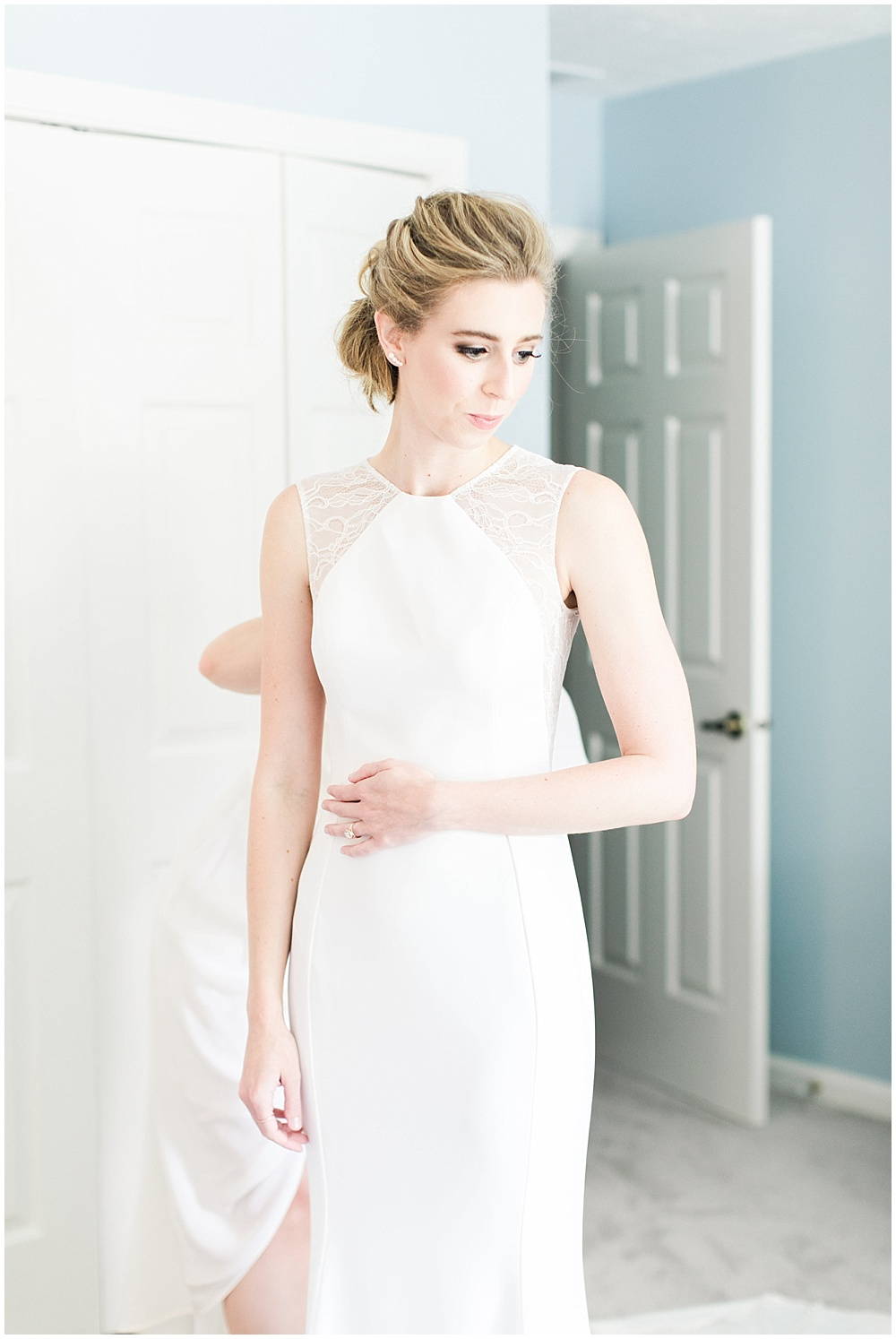 bride getting ready; lace BHLDN wedding dress; Spring floral + gold wedding | Ivan & Louise Images | Jessica Dum Wedding Coordination