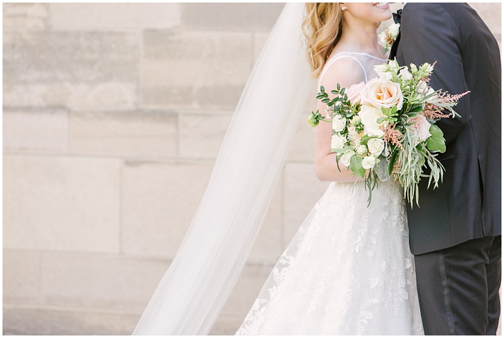bride and groom portraits; white wedding dress; blush and white bridal bouquet with greenery; Navy + blush wedding; Scottish Rite Cathedral Indianapolis | Traci & Troy Photography and Jessica Dum Wedding Coordination