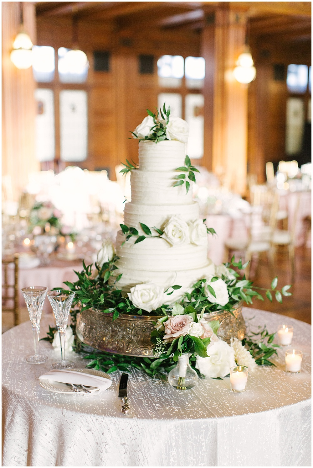white wedding cake with greenery; Navy + blush wedding; Scottish Rite Cathedral Indianapolis | Traci & Troy Photography and Jessica Dum Wedding Coordination