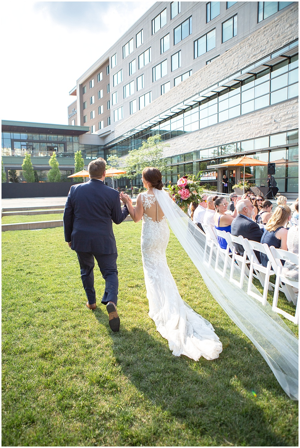 bride and groom ceremony exit, courtyard ceremony, Colorful, modern wedding at The Alexander Hotel | Conforti Photography and Jessica Dum Wedding Coordination