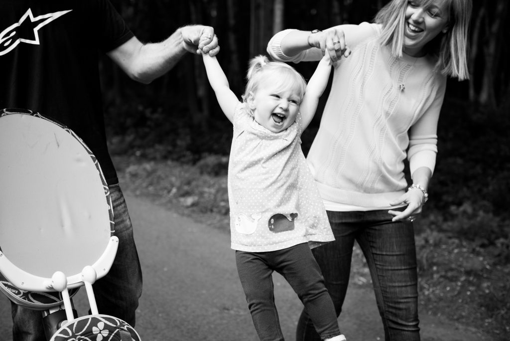 Parents lift daughter happy moment