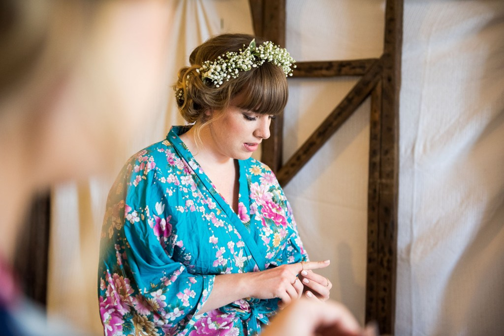 Bridesmaid wearing floral robe with floral crown Cornwall