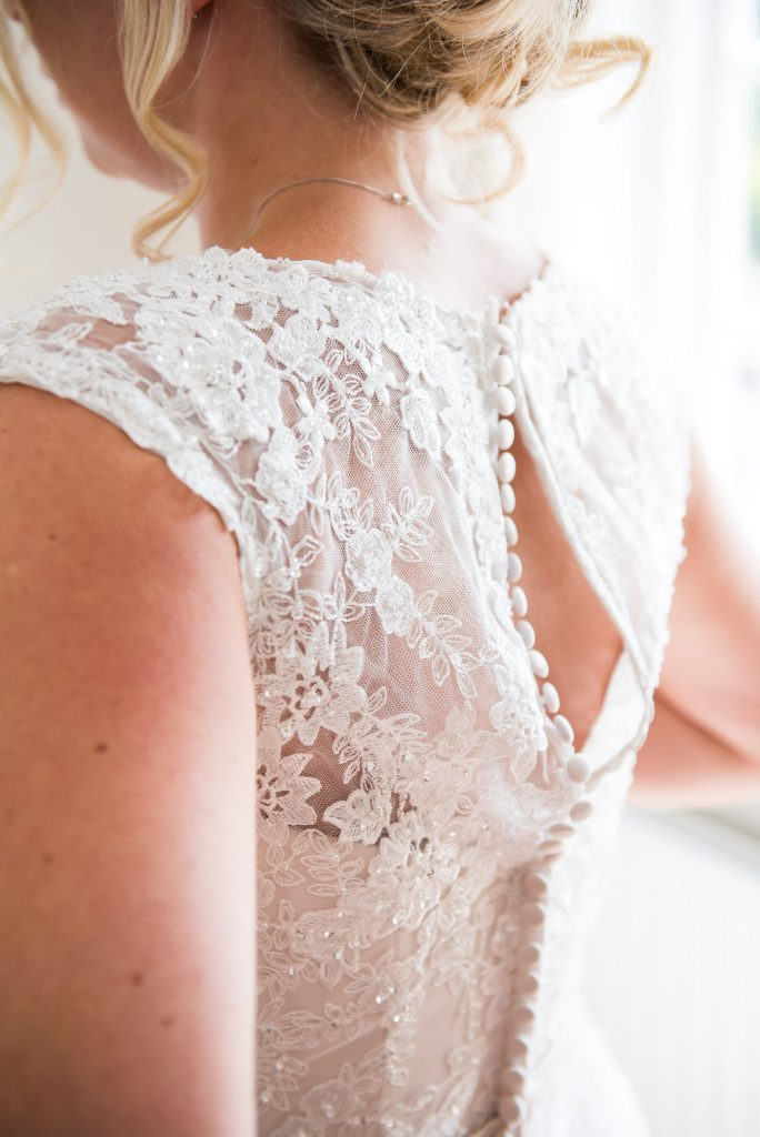 Lace bridal dress with buttons Ronald Joyce