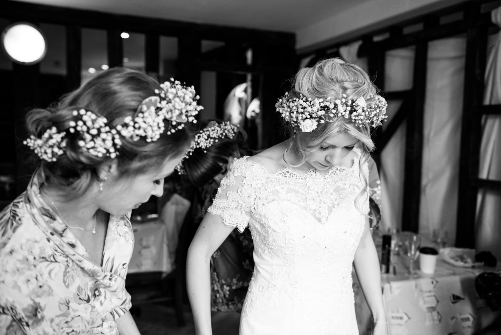 Bride wearing lace dress with boho floral crown Cornwall
