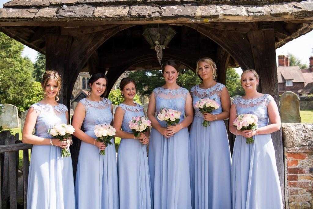 Coast bridesmaids holding Hannah Martin Flowers