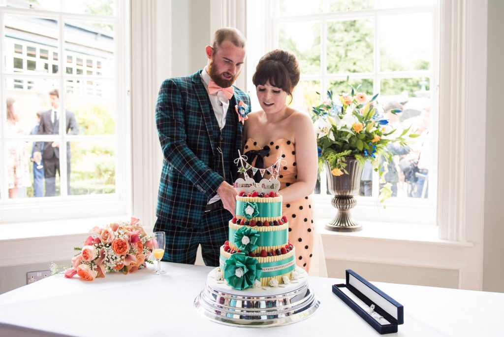 Bride with groom cut Cathy Rose Cakes alternative theatre wedding Berkshire