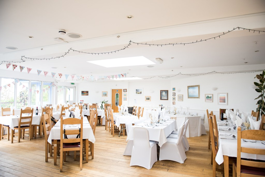 Rustic bunting decor for Cornwall wedding