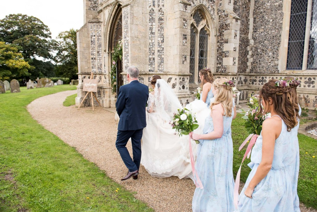 Bride with father walking to church Norfolk