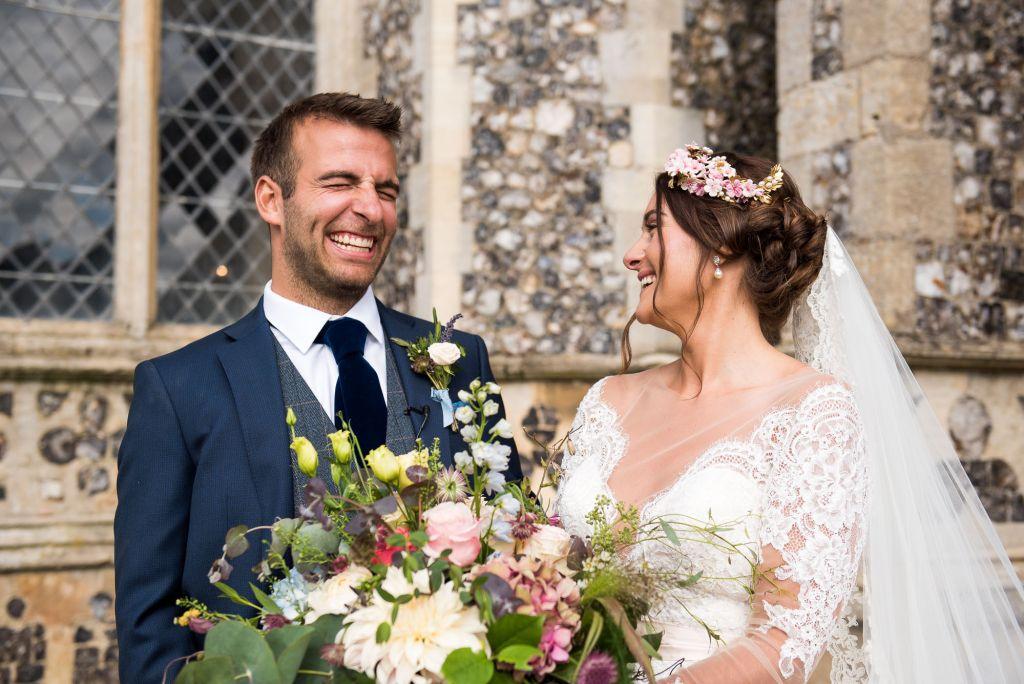 Laughing Jay West Bride with groom Norfolk wedding portrait