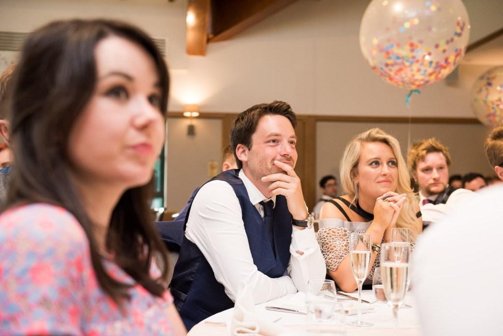Wedding guests listen to wedding speeches Berkshire