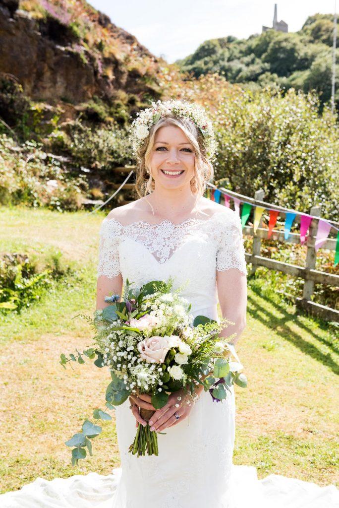 Natural boho bride wearing Gysophila floral crown holding Flowershed Trebilocks Flowers