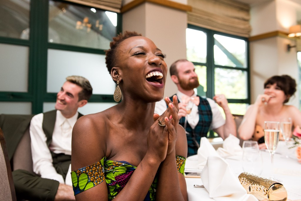 Wedding guests laugh during speeches Berkshire