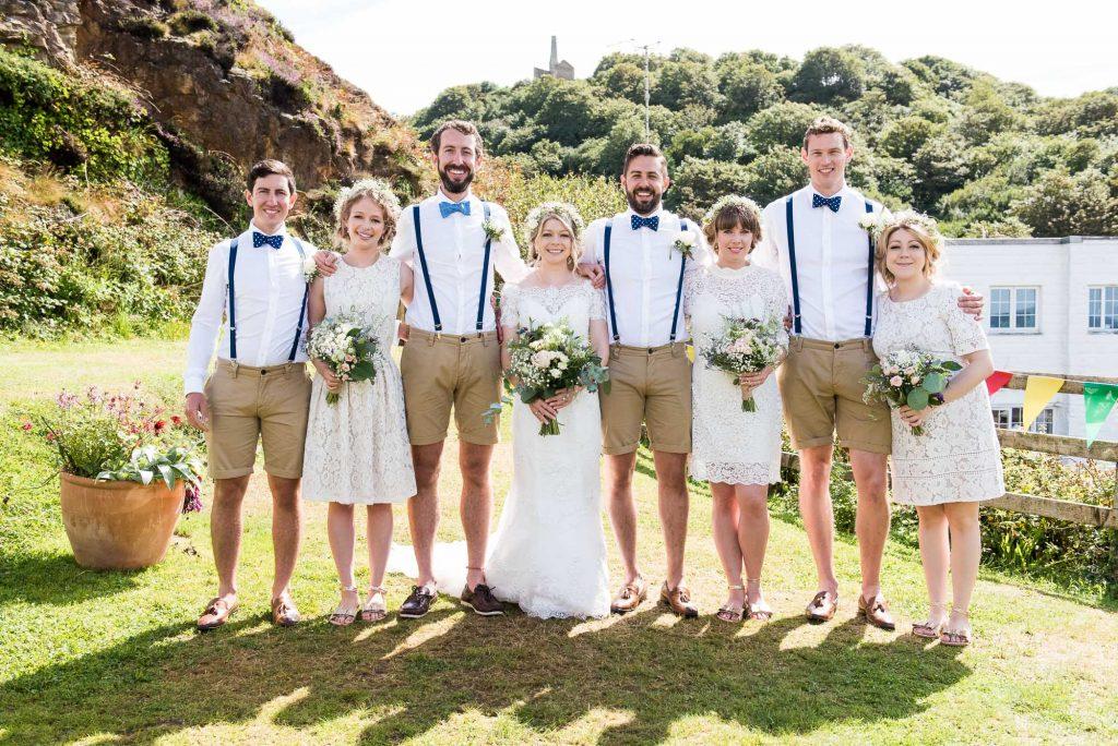 Creative boho themed wedding group portrait Cornwall