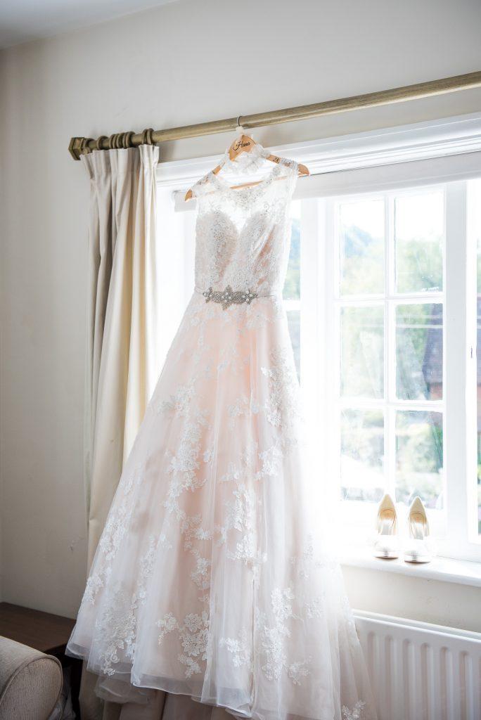 Ronald Joyce hanging bridal dress
