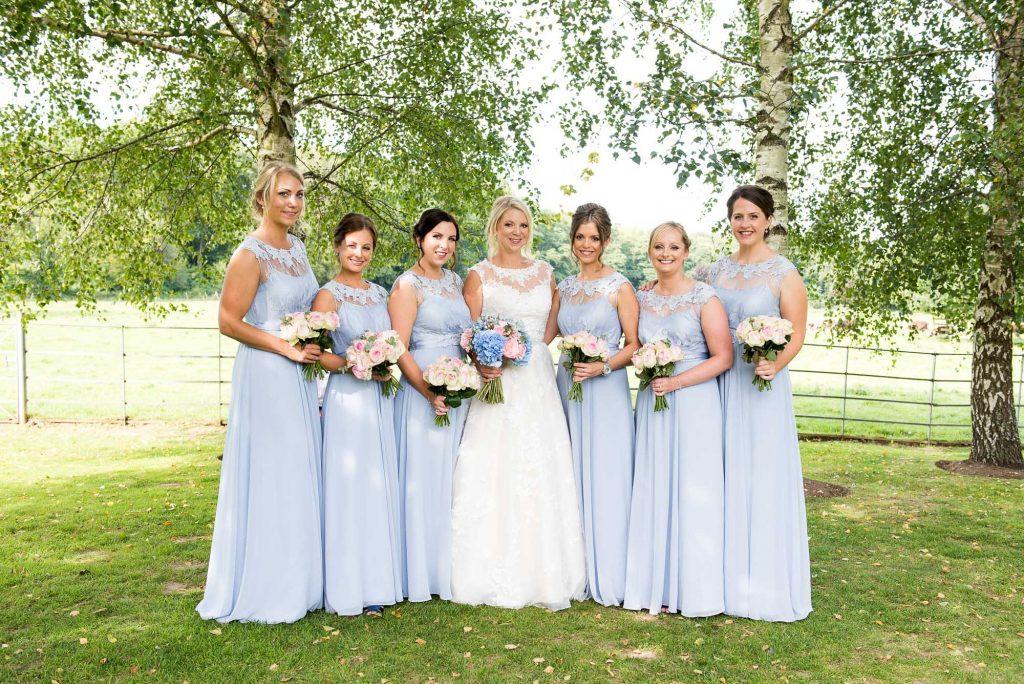 Ronald Joyce bride with pastel Coast bridesmaids