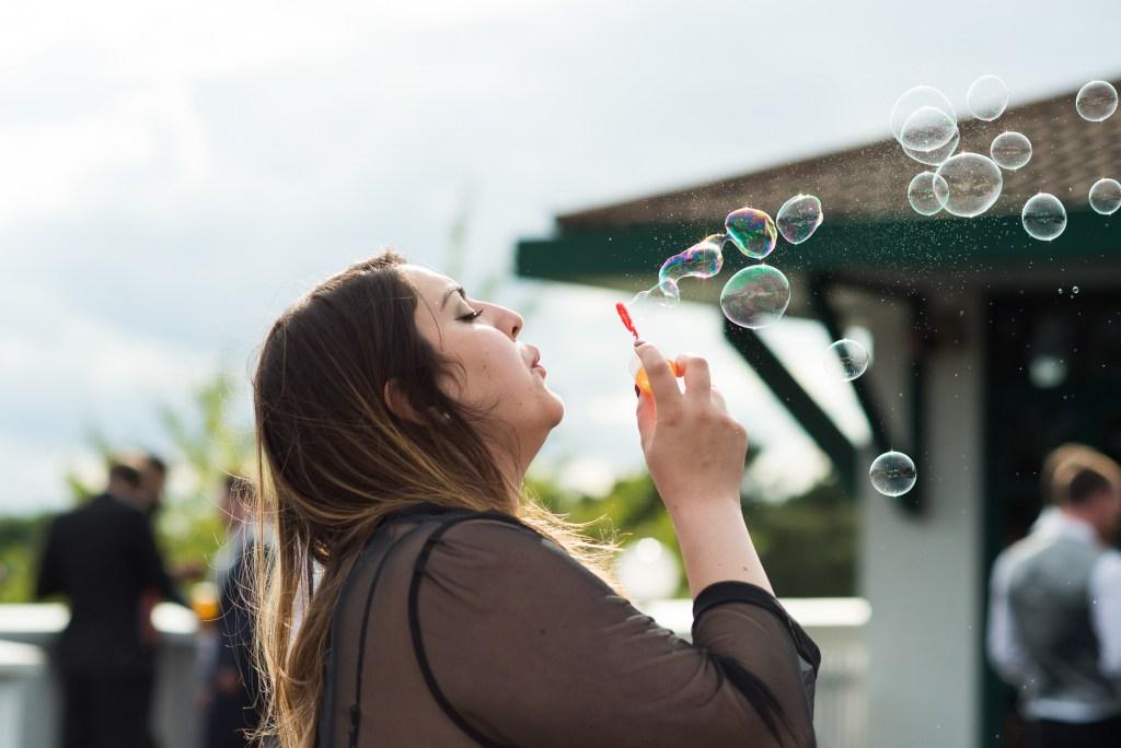 Wedding guest blows fun bubbles theatre wedding Berkshire