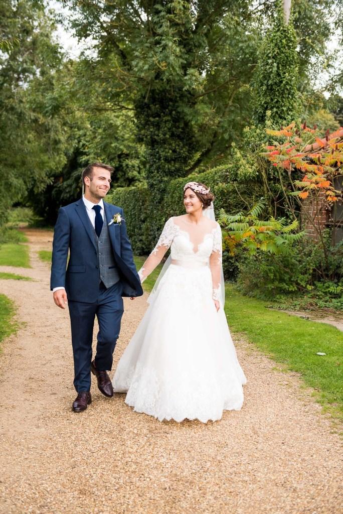 Natural wedding portrait with Calvin Klein groom and Jay West Bride Norfolk