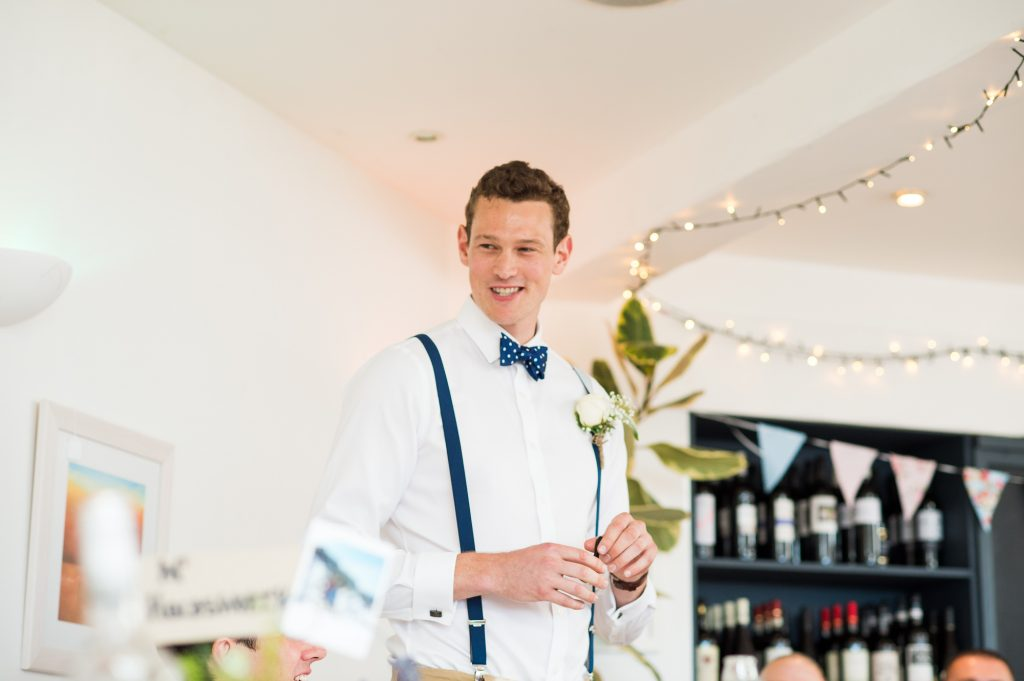 Best man delivers speech Cornwall beach wedding