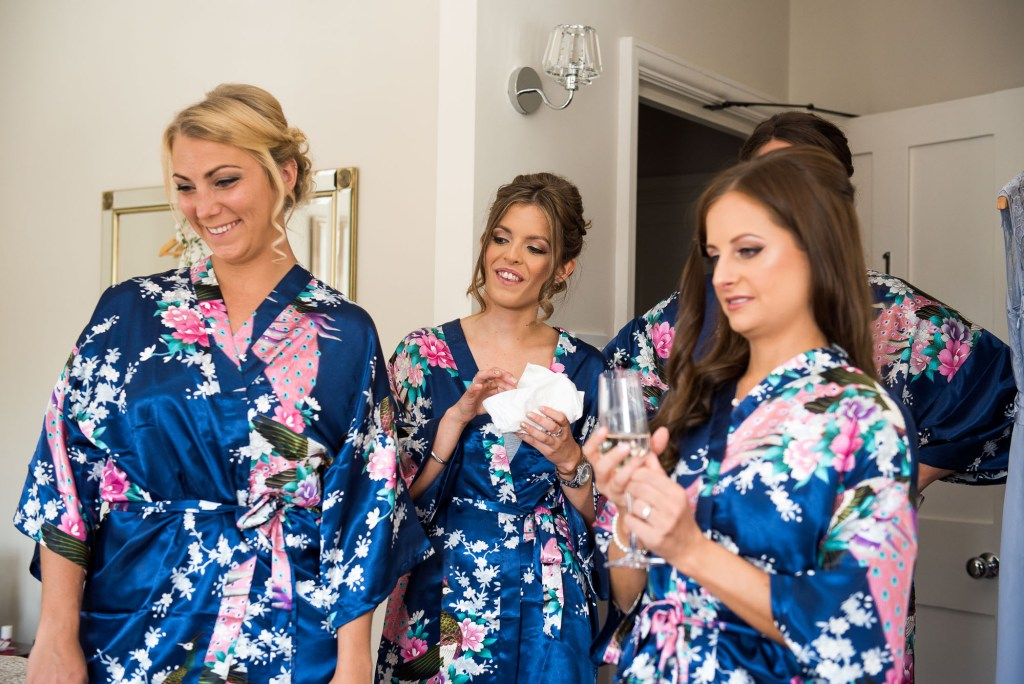 Bridesmaids wearing floral robes pre wedding photography