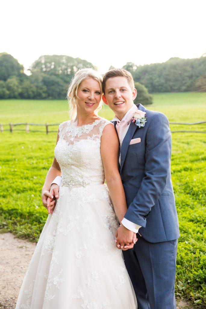 Ashworth & Bird groom with Ronald Joyce bride countryside portrait