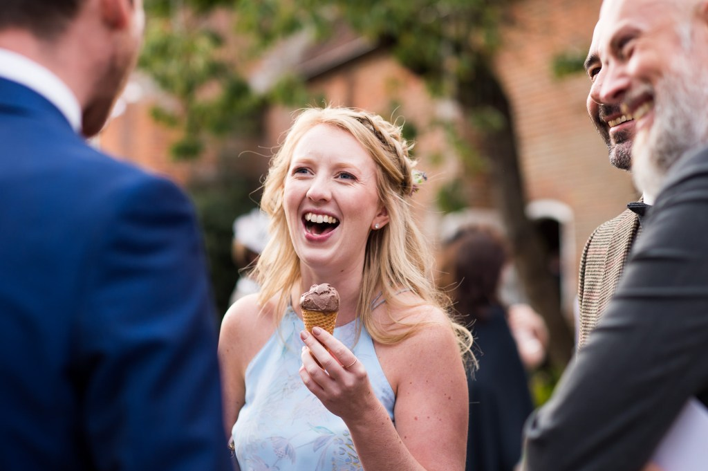 Smiling wedding guest with ice cream Norfolk Barn Wedding