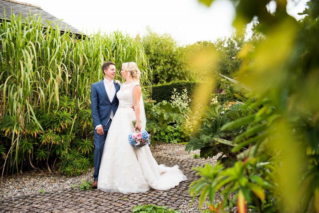Ronald Joyce bride with Hannah Martin bouquet with groom summer wedding