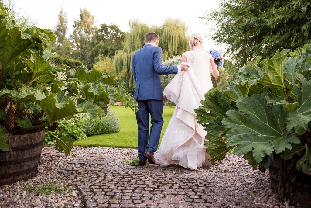 Ashworth & Bird groom holding bridal dress