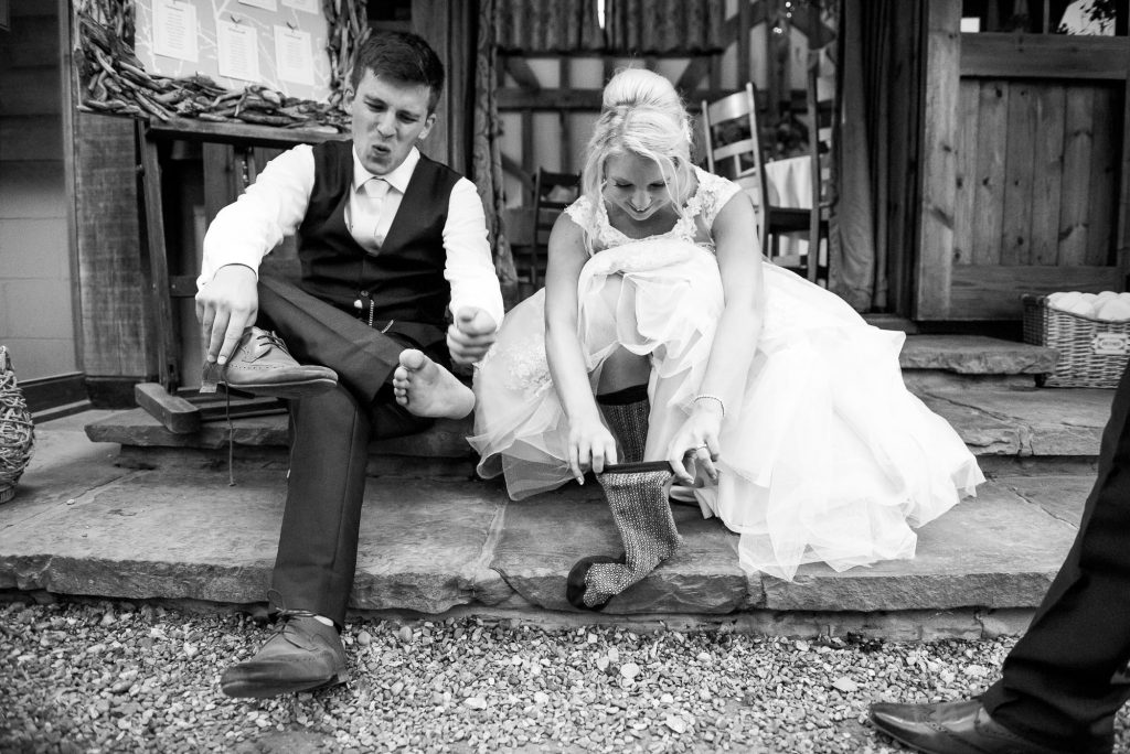 Bride with groom take off shoes