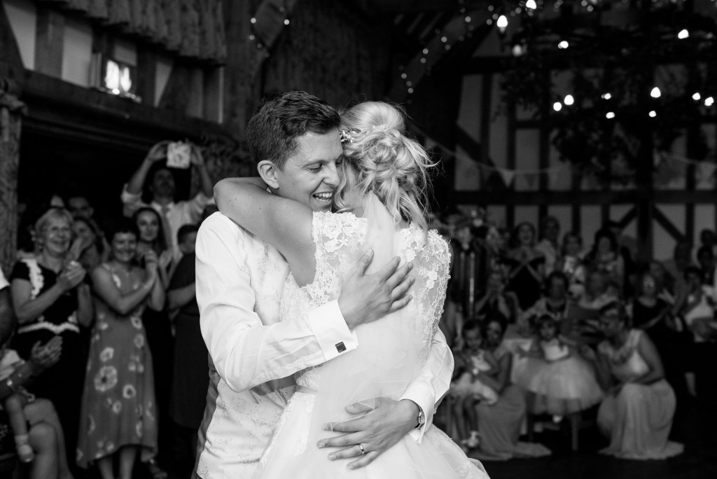 Groom with bride hug after first dance