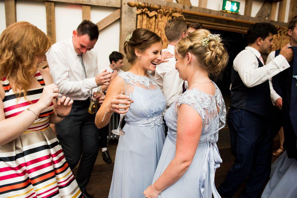 Coast pastel blue bridesmaids dancing