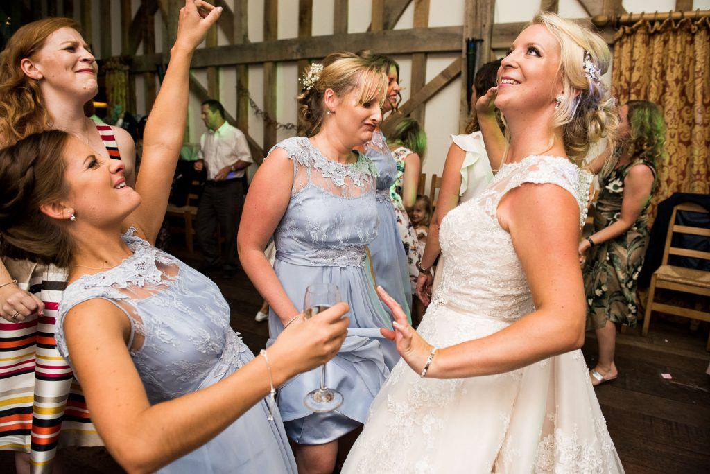 Ronald Joyce bride with Coast bridesmaids fun dancing